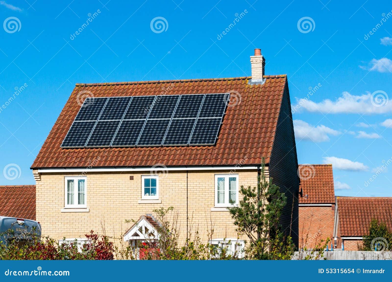 Solar Photovoltaic Panel Array On House Roof Against A Blue Sky Stock ...