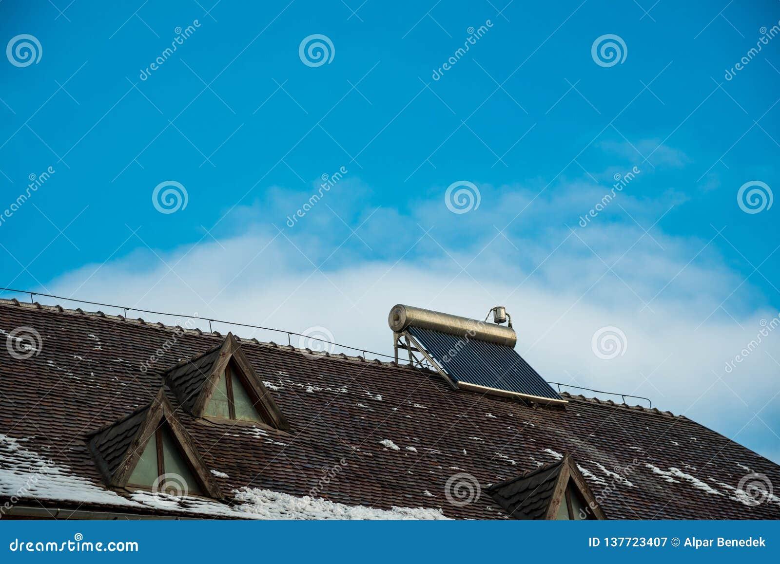 Solar water heater boiler on old buildings rooftop
