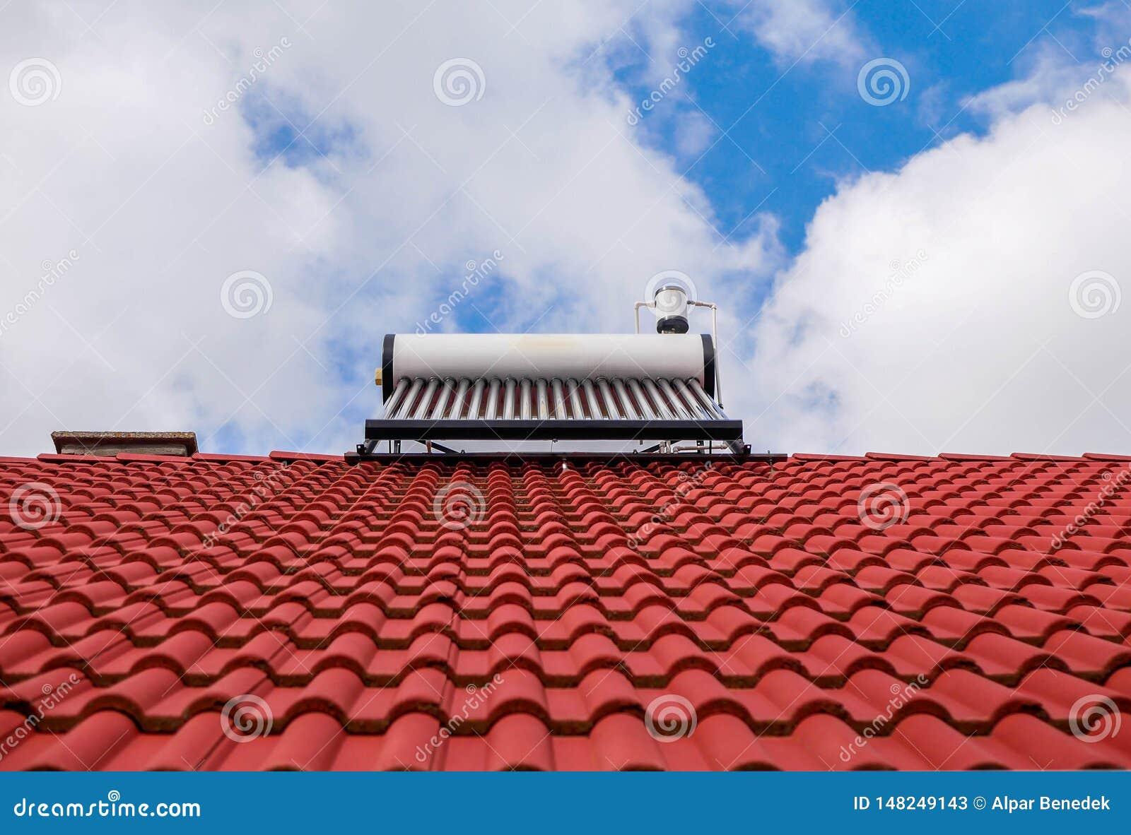 Solar water heater boiler on rooftop, blue sky