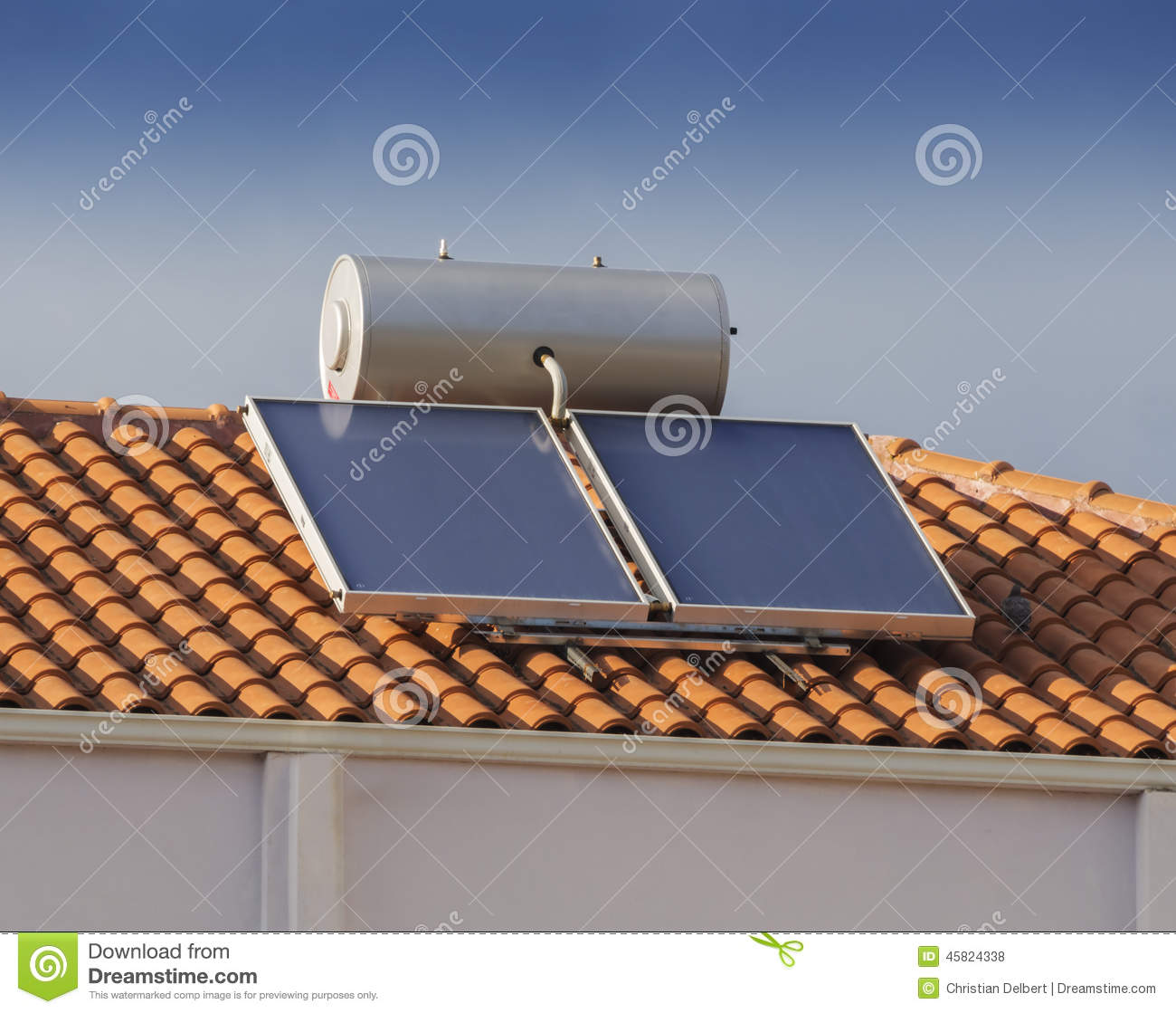 Solar water heater on roof of house stock photo image for Tin can solar heater