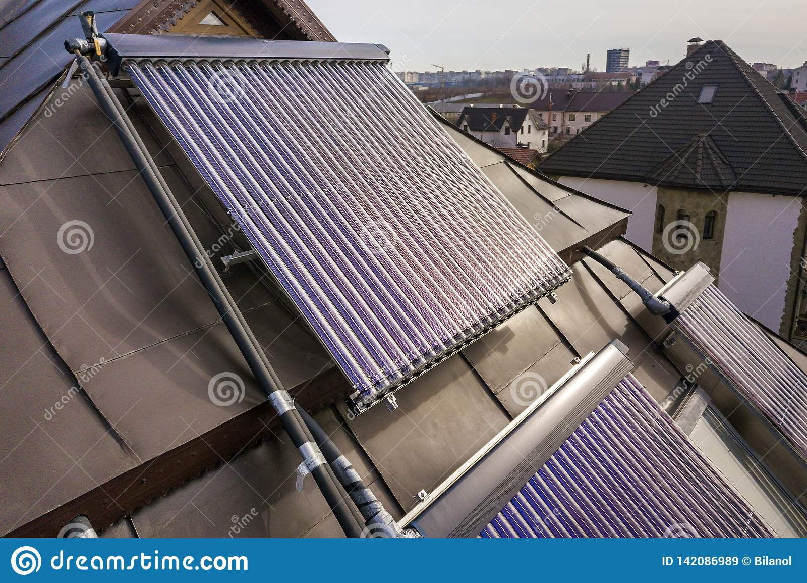 Solar water heating system on house roof. Hot water boiler, alternative ecological sun energy generator. Modern technology concept