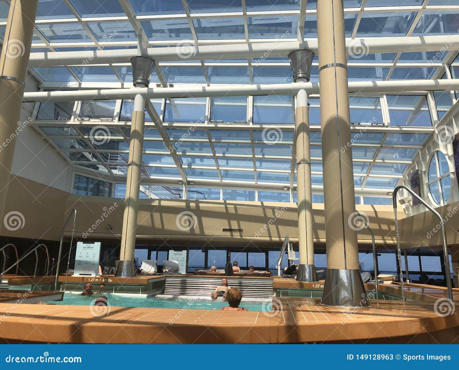 The Solarium, indoor pool onboard cruise ship.