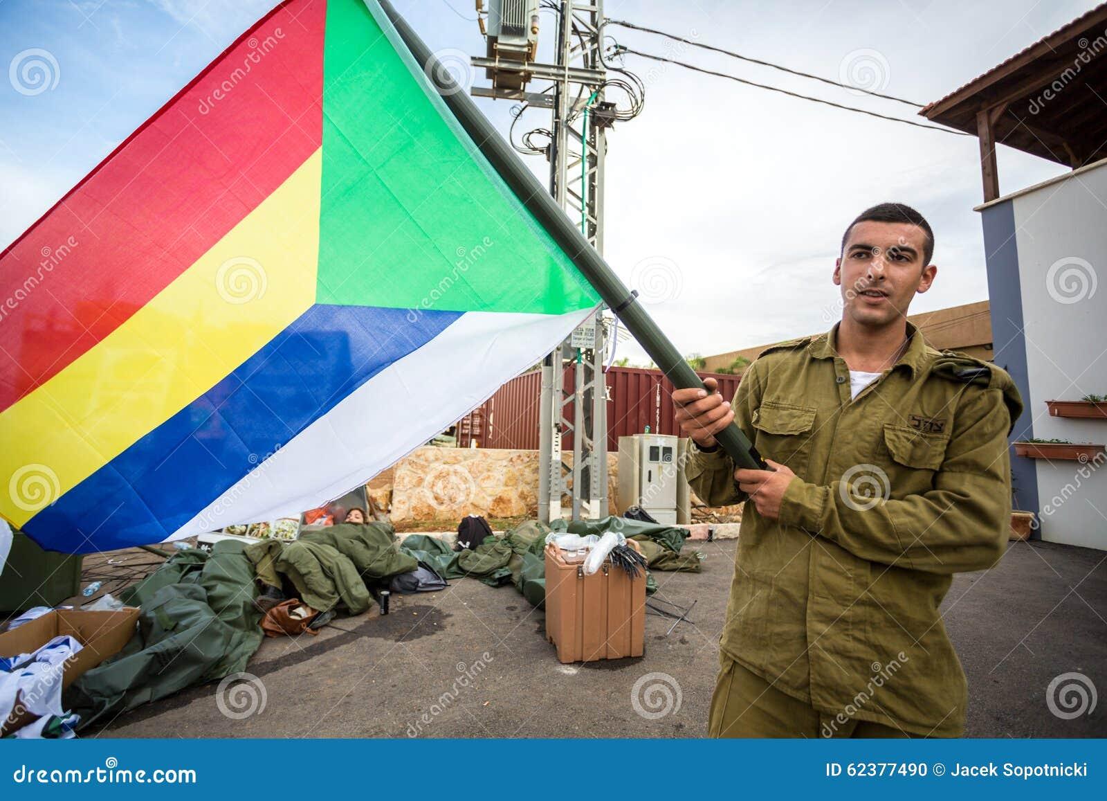 Soldat israélien avec le drapeau de Druze
