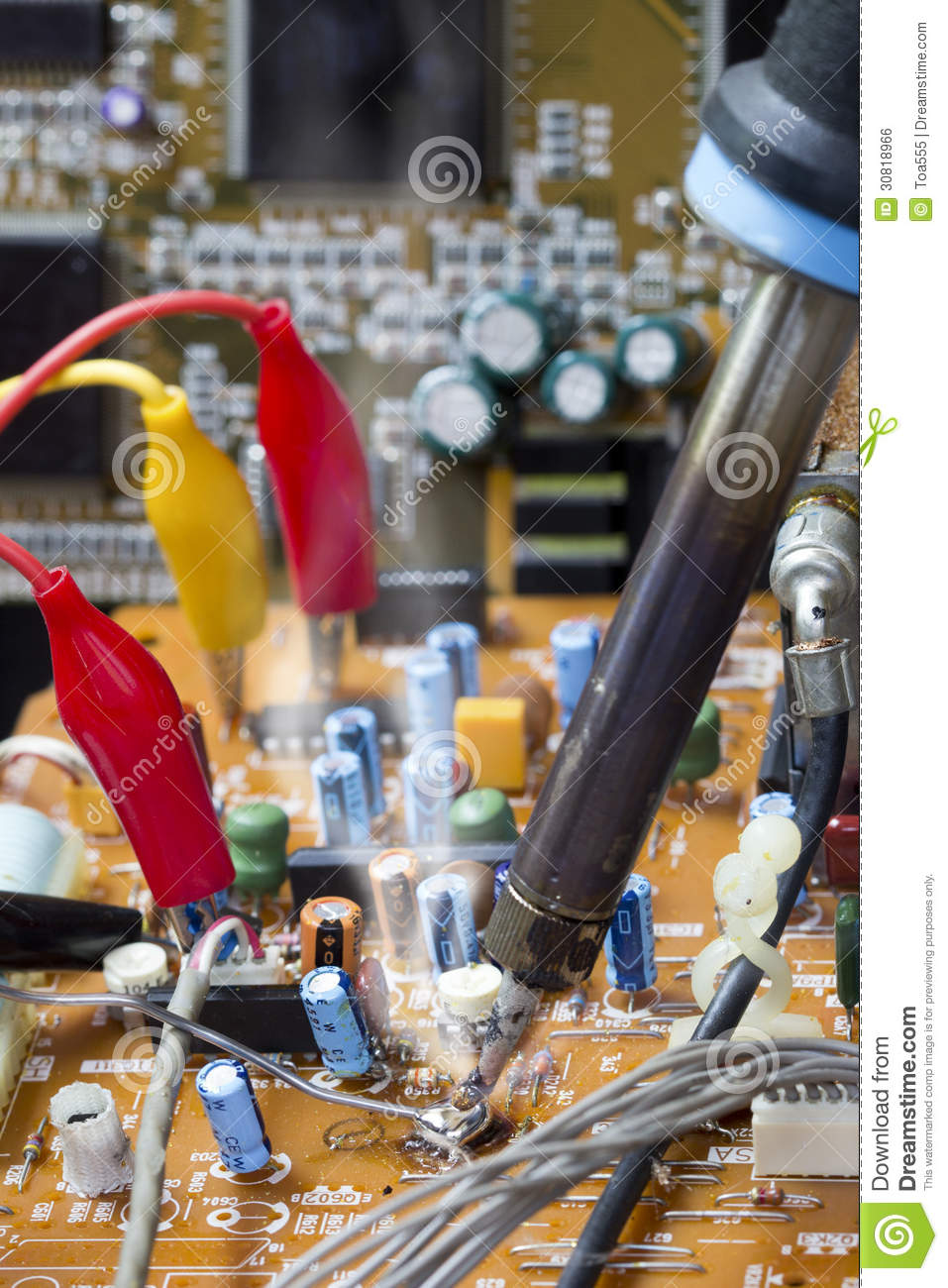 soldering iron on electronic boards royalty free stock image image 30818966. Black Bedroom Furniture Sets. Home Design Ideas