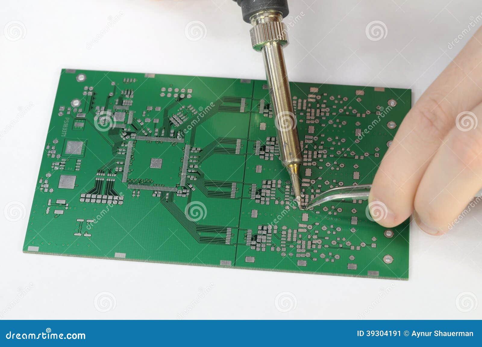 soldering resistor to printed circuit board stock photo image 39304191. Black Bedroom Furniture Sets. Home Design Ideas
