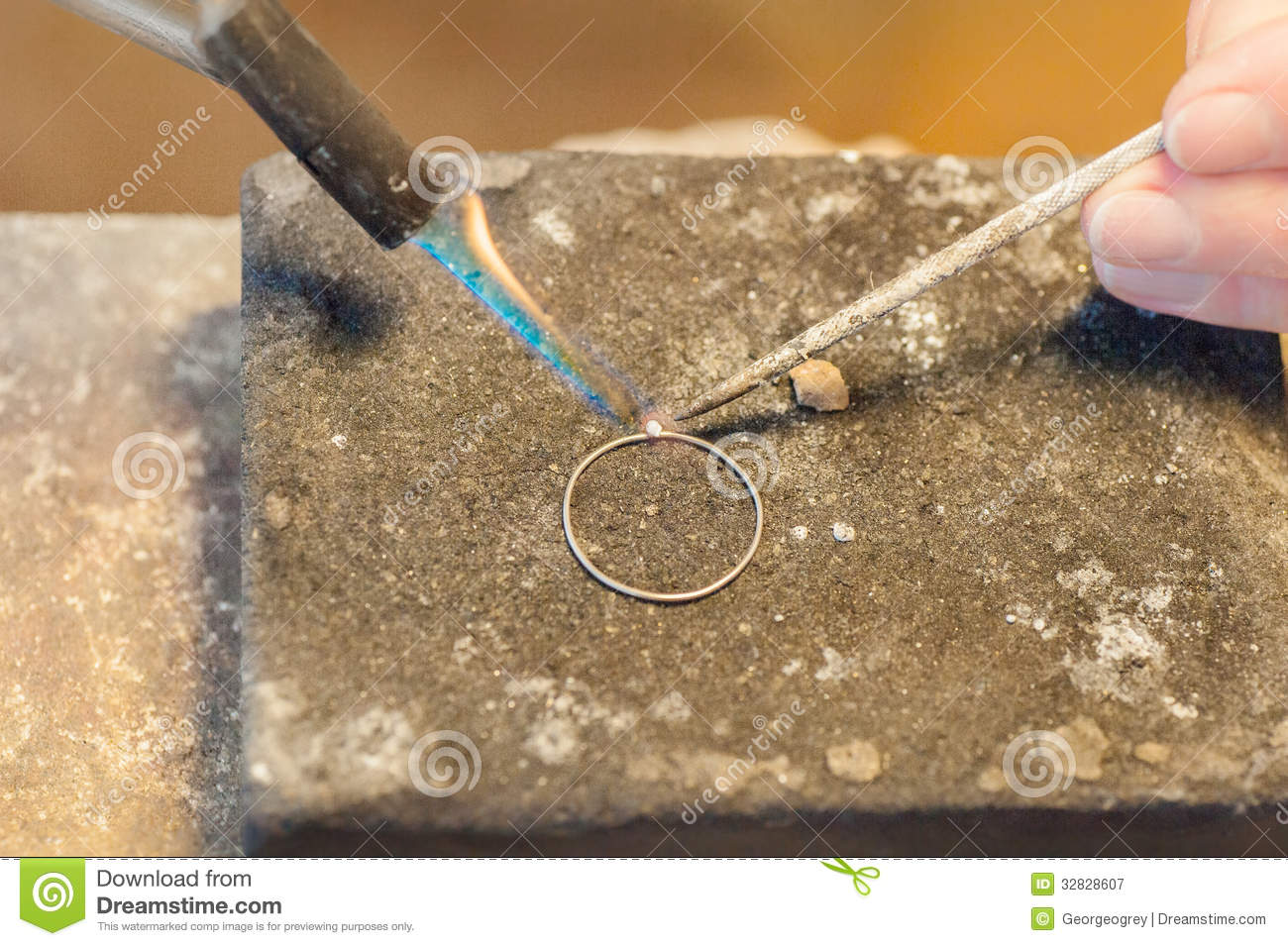 soldering a silver ring royalty free stock photography