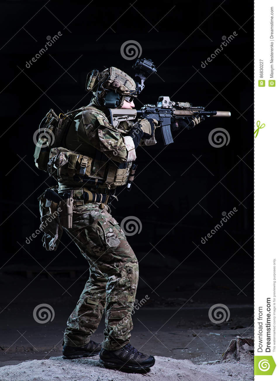 Soldier aiming from rifle on dark background