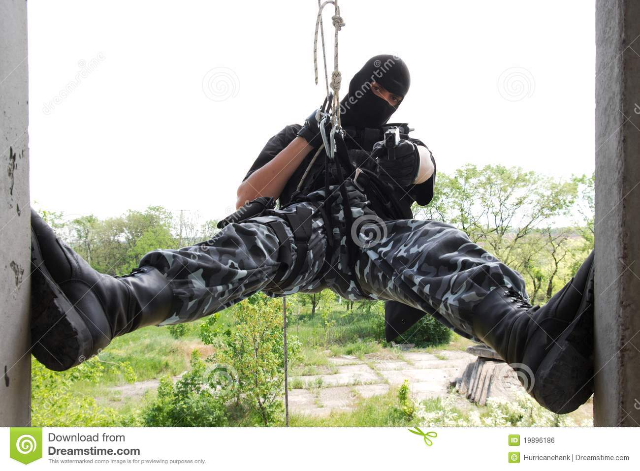 Armed Soldier Rappelling With A Gun Royalty Free Stock Photography ...