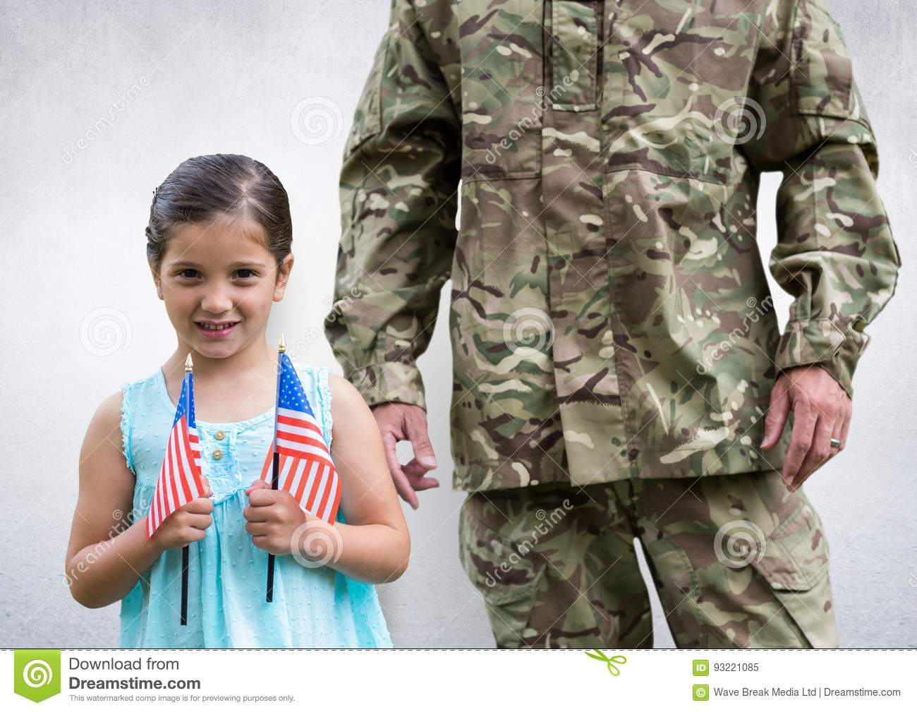 soldier and daughter with USA flags, in concrete room