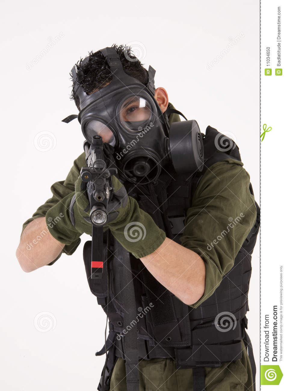 Soldier in Gas Mask, pointing a rifle and isolated against a white ...