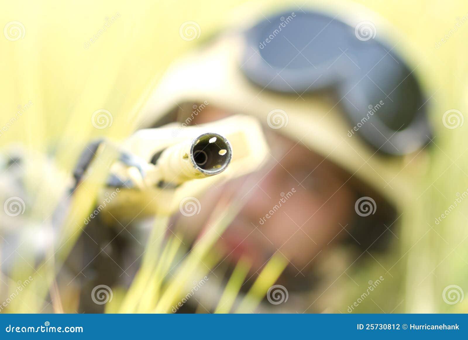 Soldier in helmet targeting with a gun