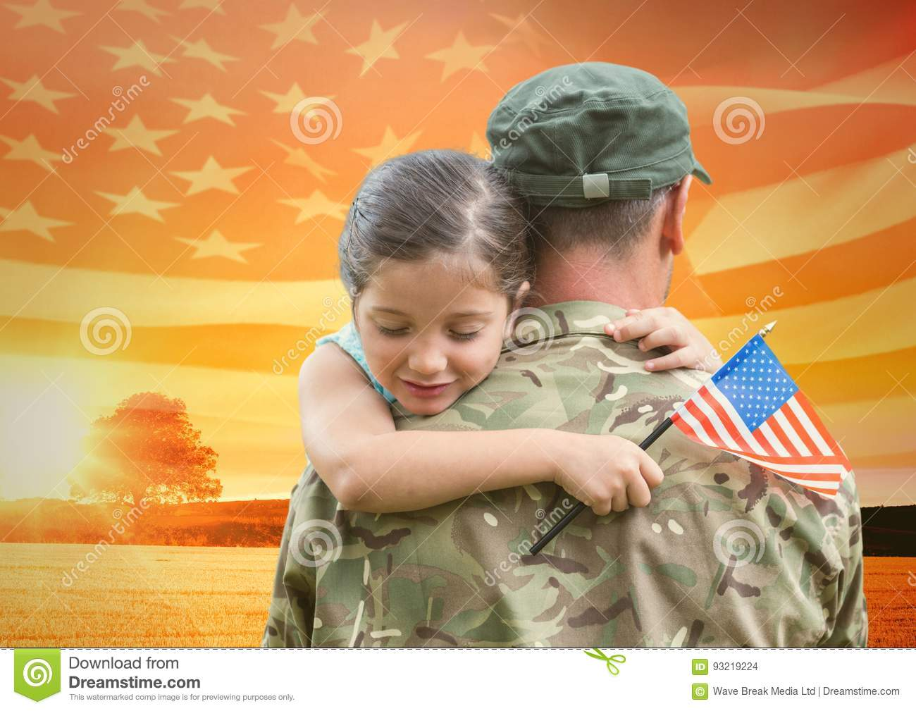 soldier hugging daughter in the field with usa flag
