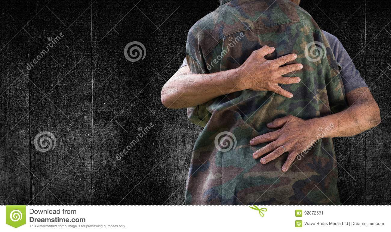 Soldier hugging mid section against black wood panel and grunge overlay