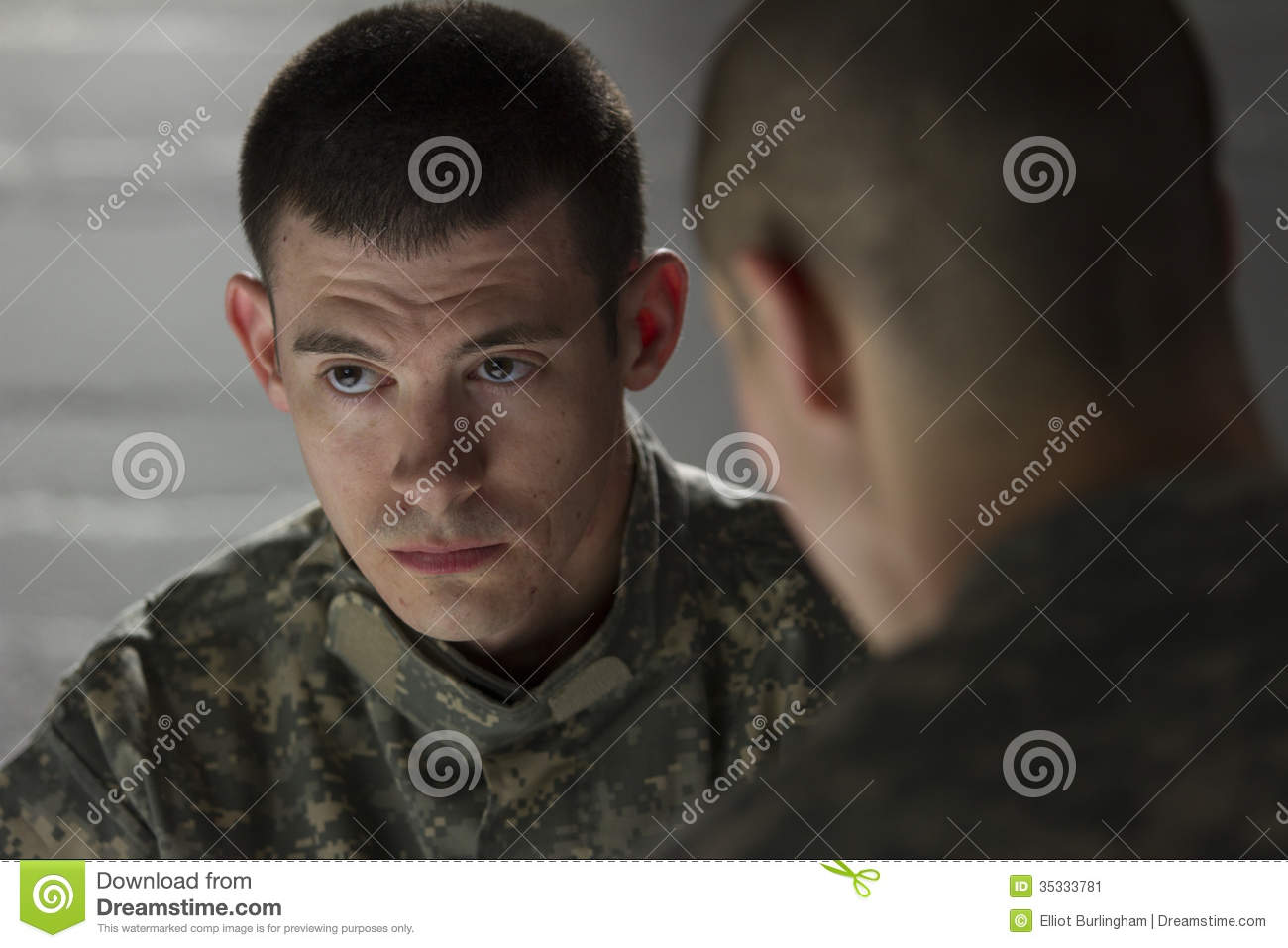 Soldier Looks Somber While Being Consoled By Peer ...