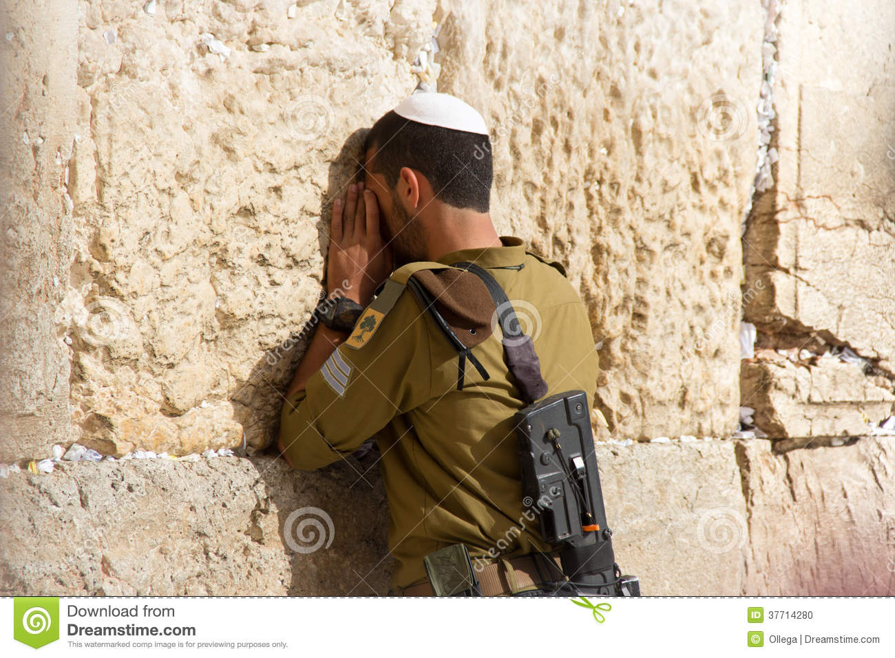 Soldier Praying At The Wailing Wall With Weapon Jerusalem