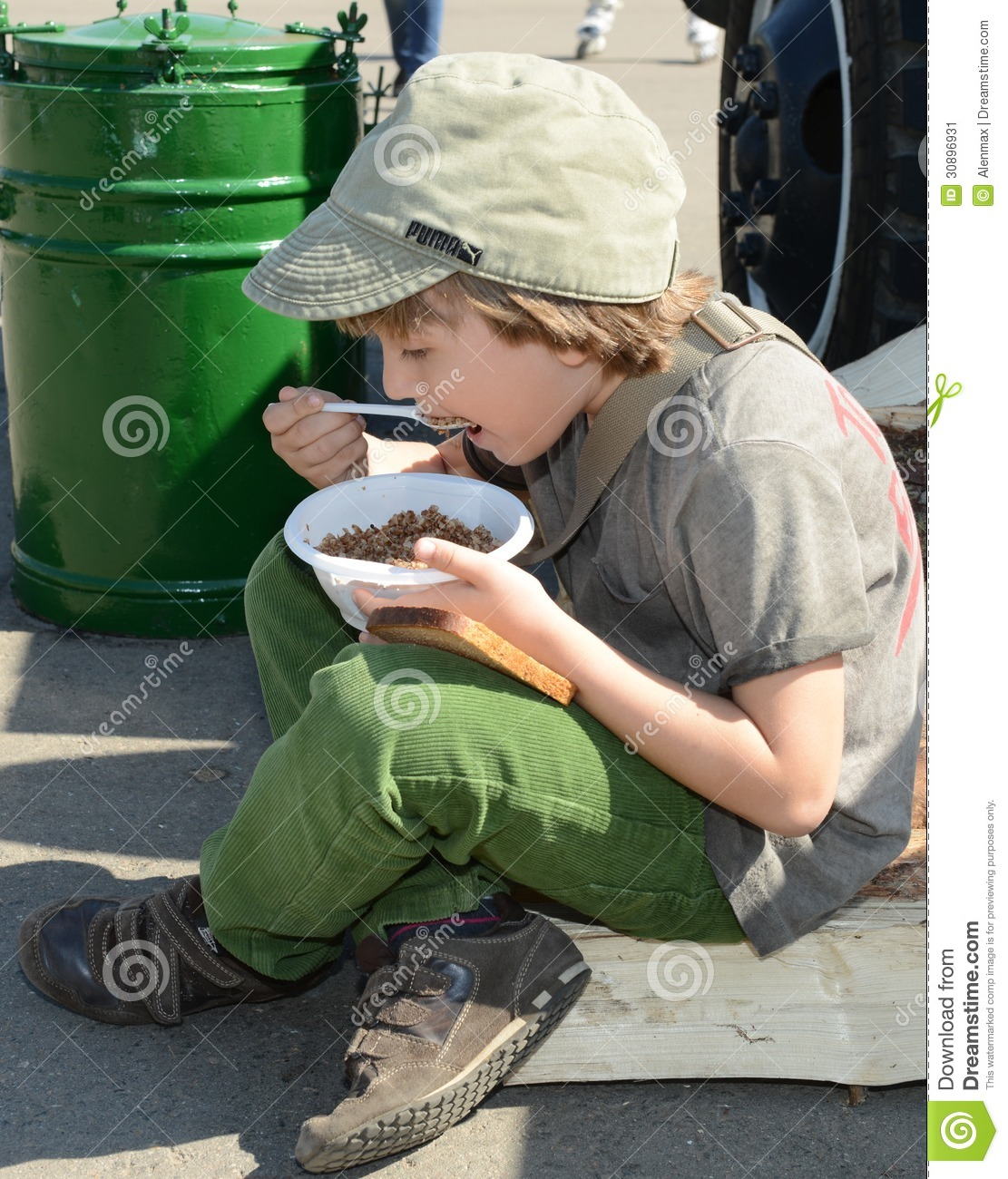 Moscow russia may 9 2013 boy eating porridge soldier in the military