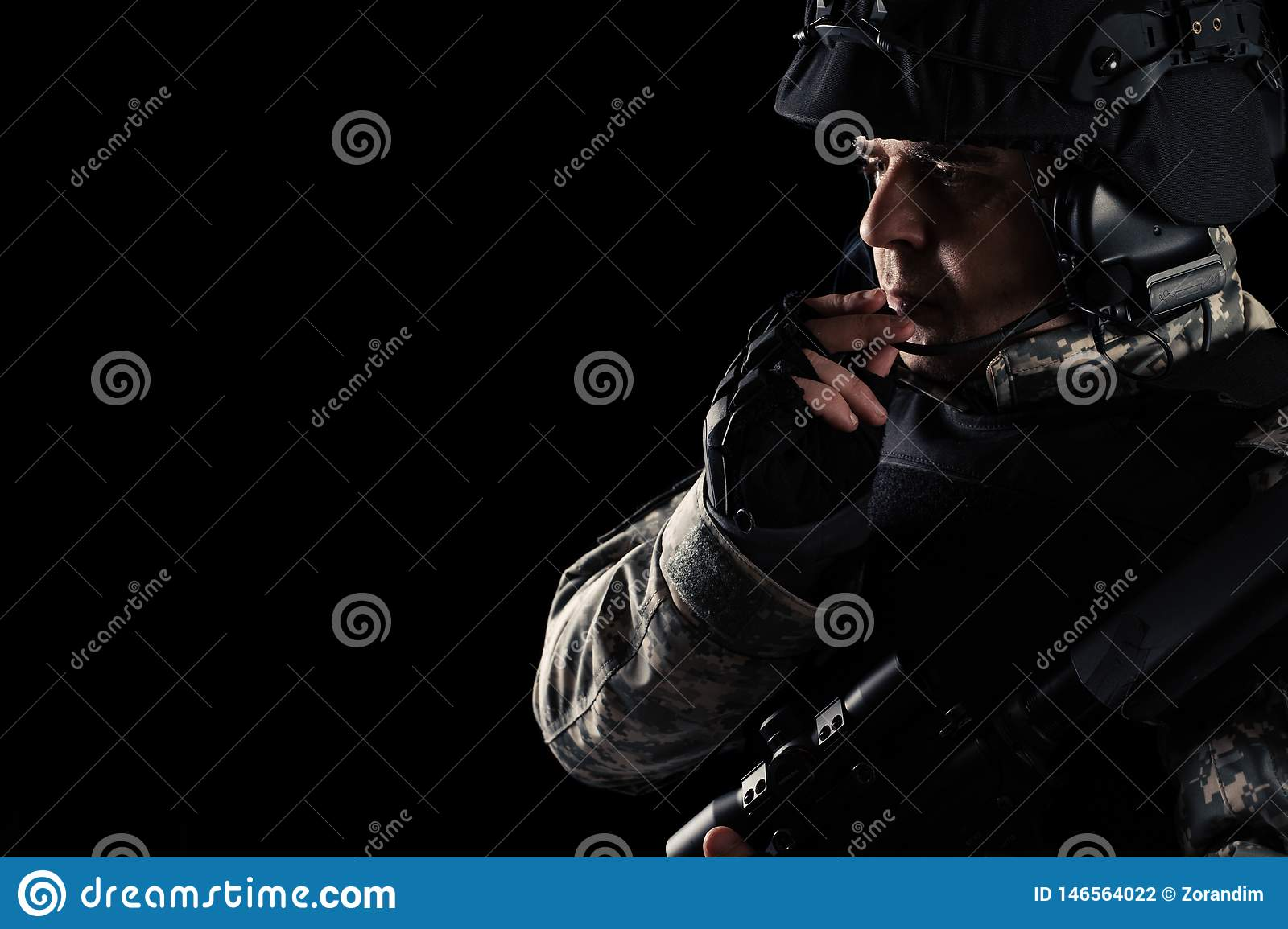Soldier special forces with rifle on dark background