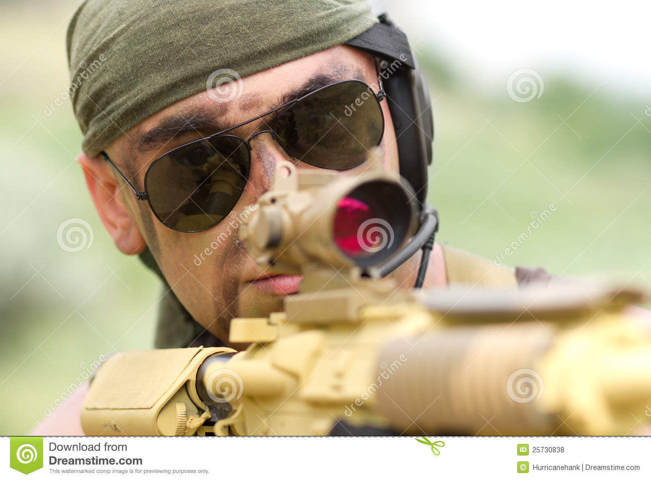 Soldier in sunglasses targeting
