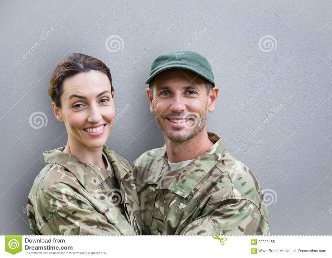 soldiers couple smiling. concrete wall