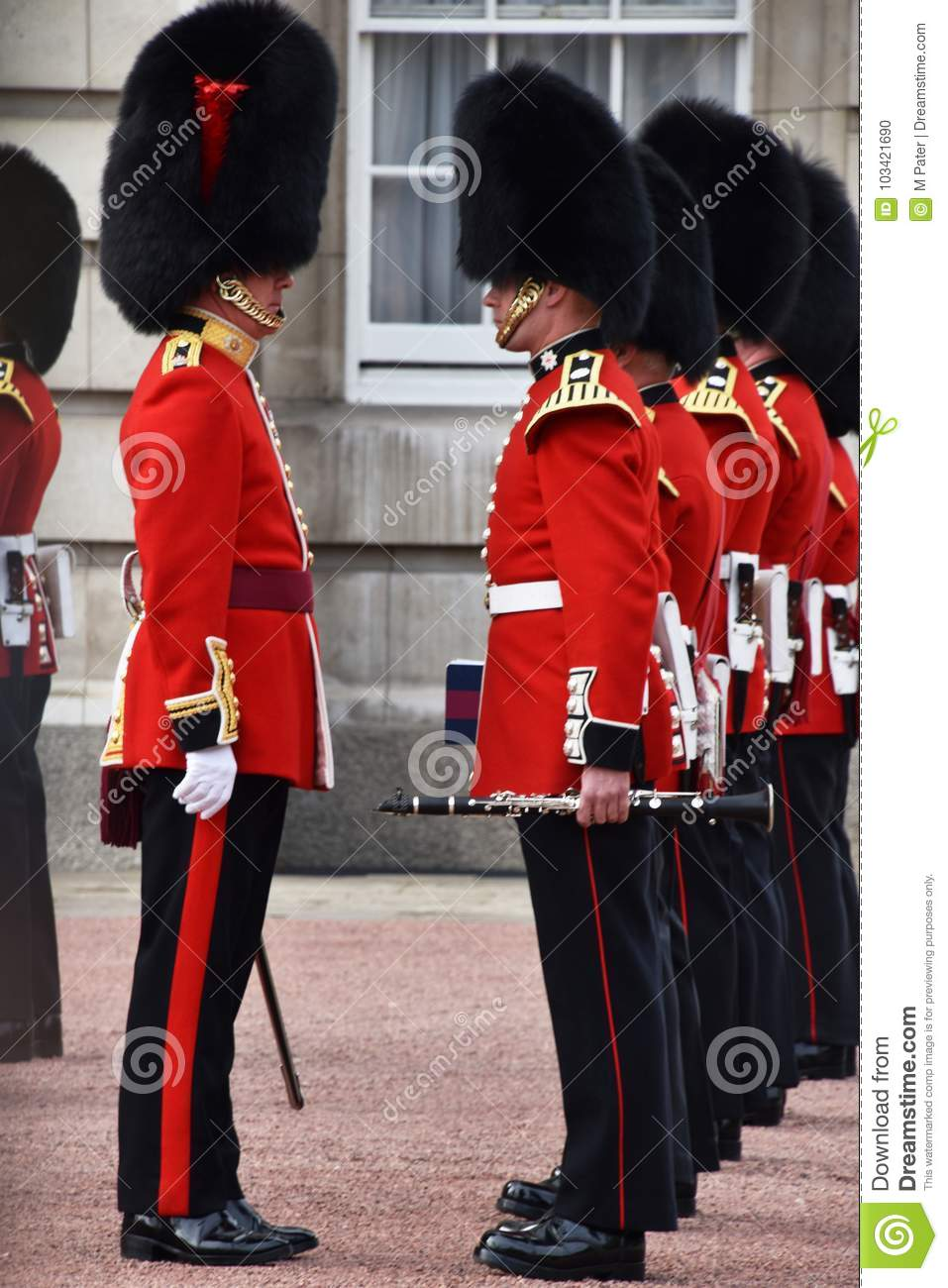 soldiers at changing of the guard time at buckingham palace