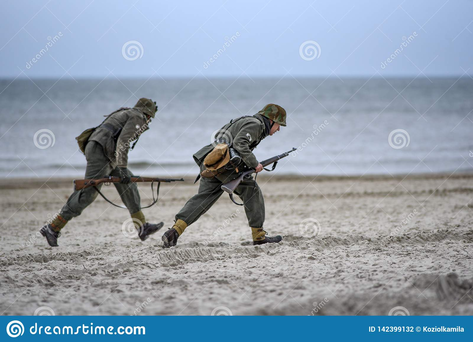 Soldiers Fighting On The Beach During The Reconstruction Of