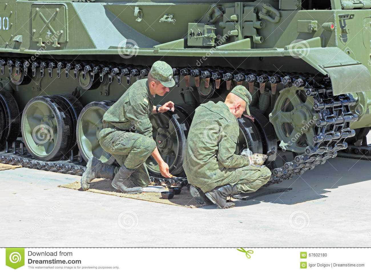The Soldiers Paint Military Equipment Editorial Image