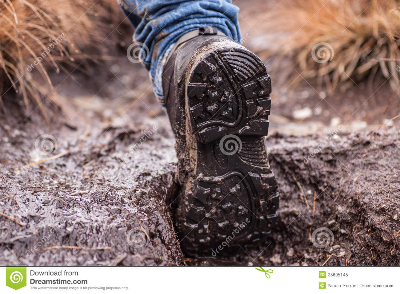 sole of an hiking shoe covered in mud royalty free stock
