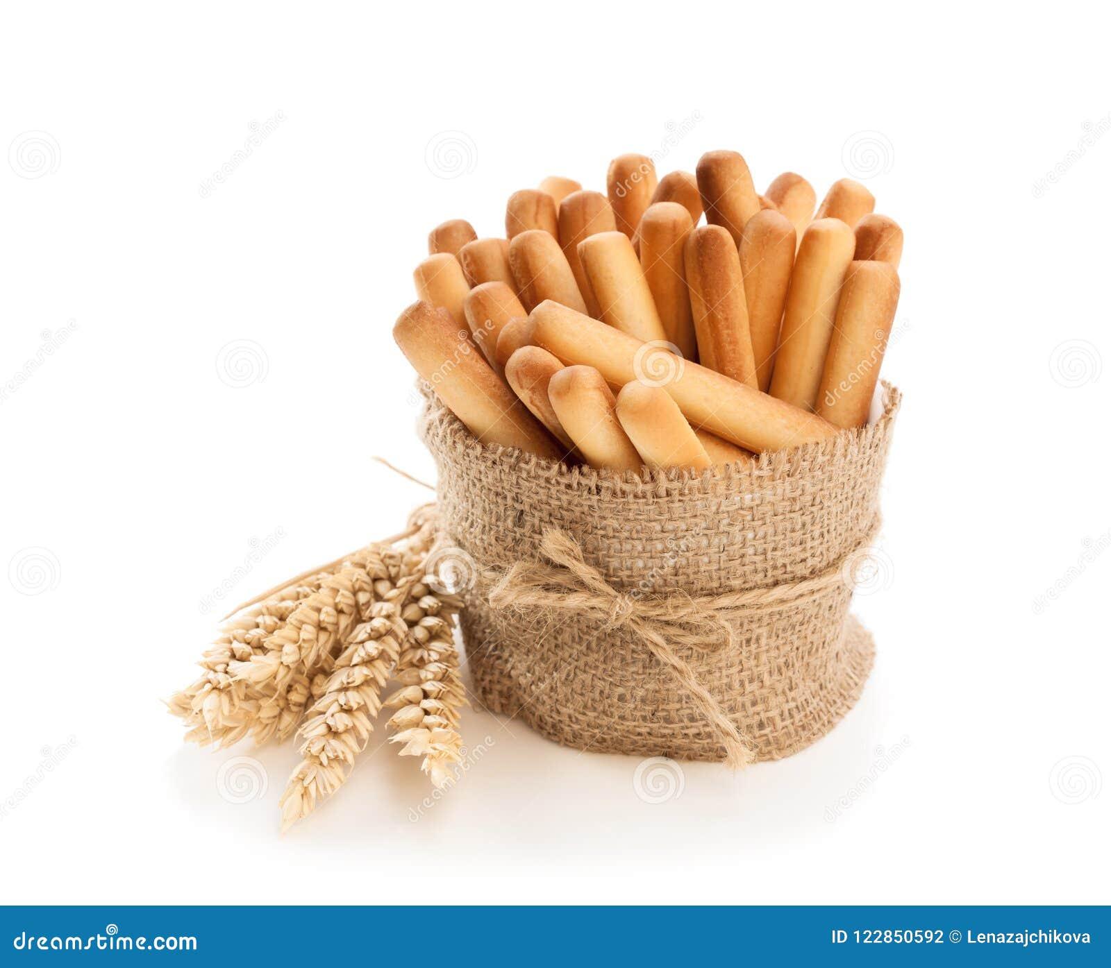 Soleni chlebowi kije z pszenicznymi ucho odizolowywającymi na bielu