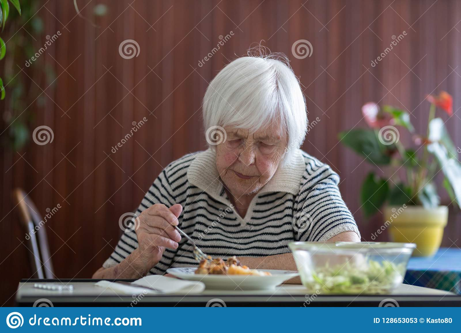 Fabulous Solitary Senior Woman Eating Her Lunch At Retirement Home Download Free Architecture Designs Scobabritishbridgeorg