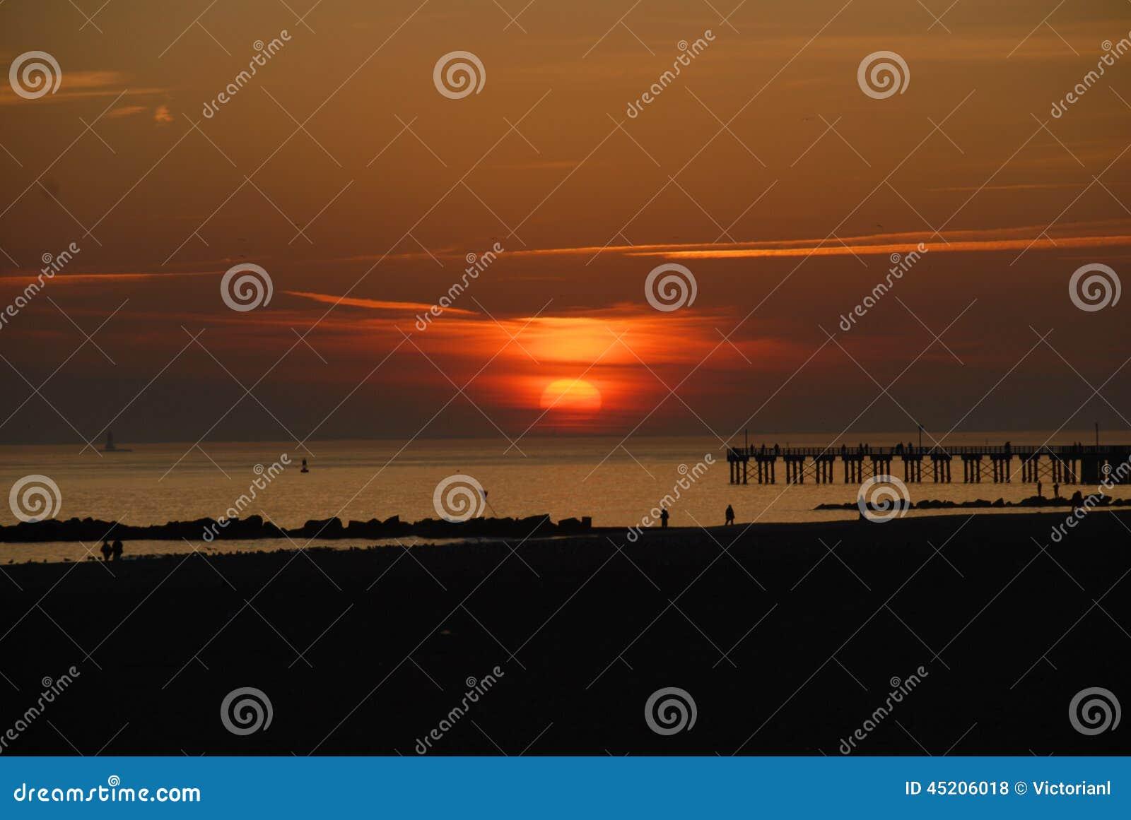 Solnedgång från Brighton Beach, New York City