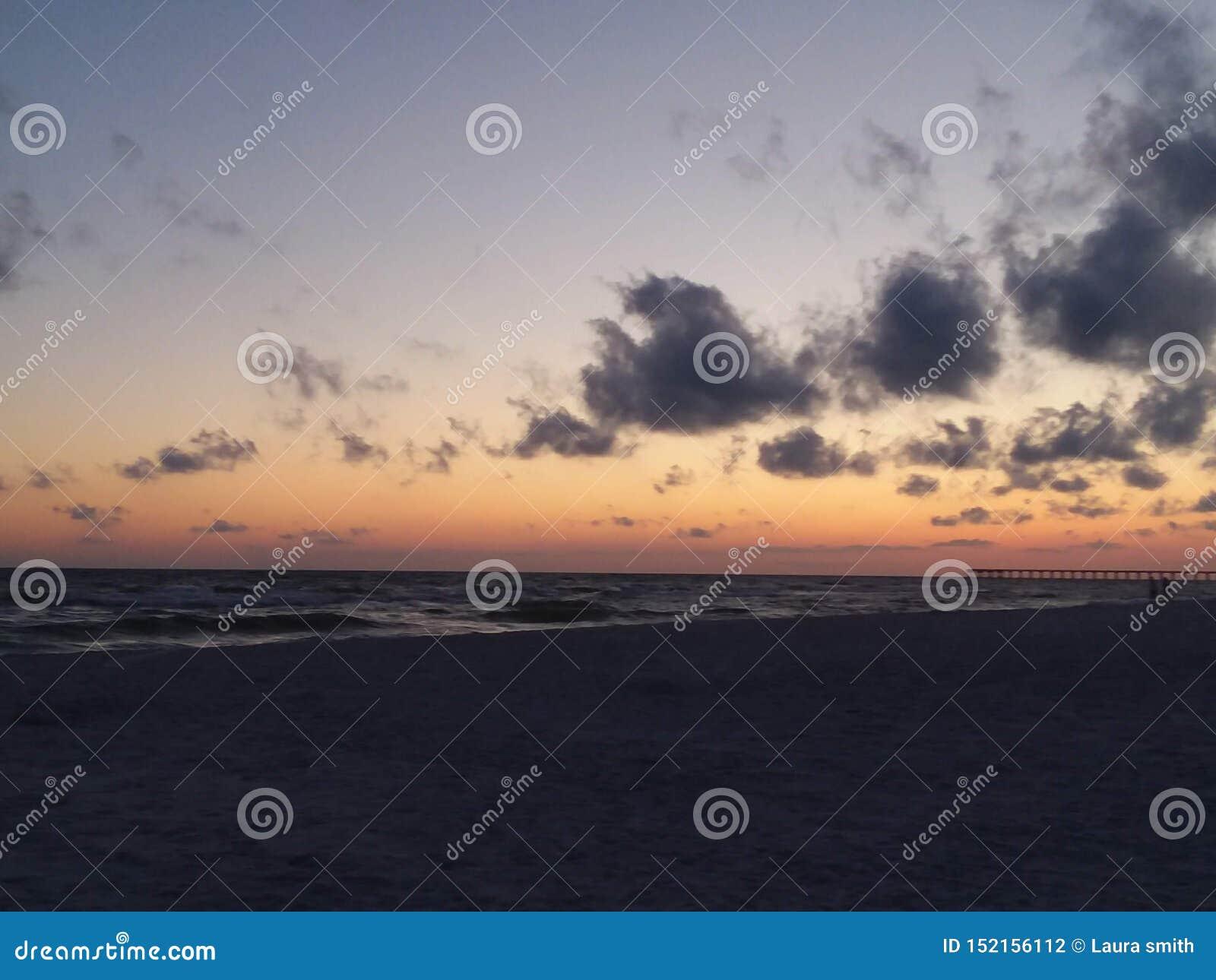 Solnedgångstranden visar beauty& x27; s till allt