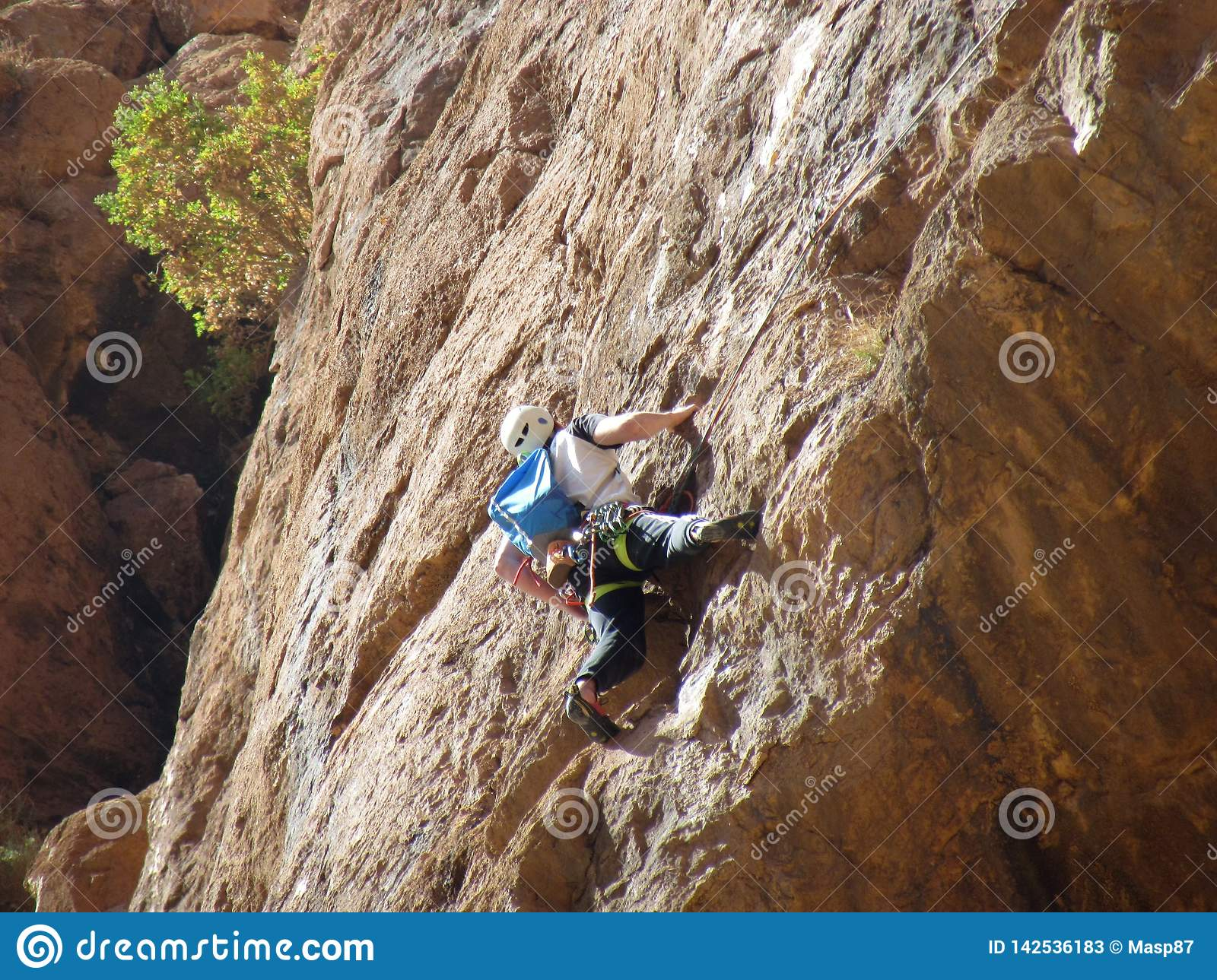 Solo climber in Todra Gorges in Morocco