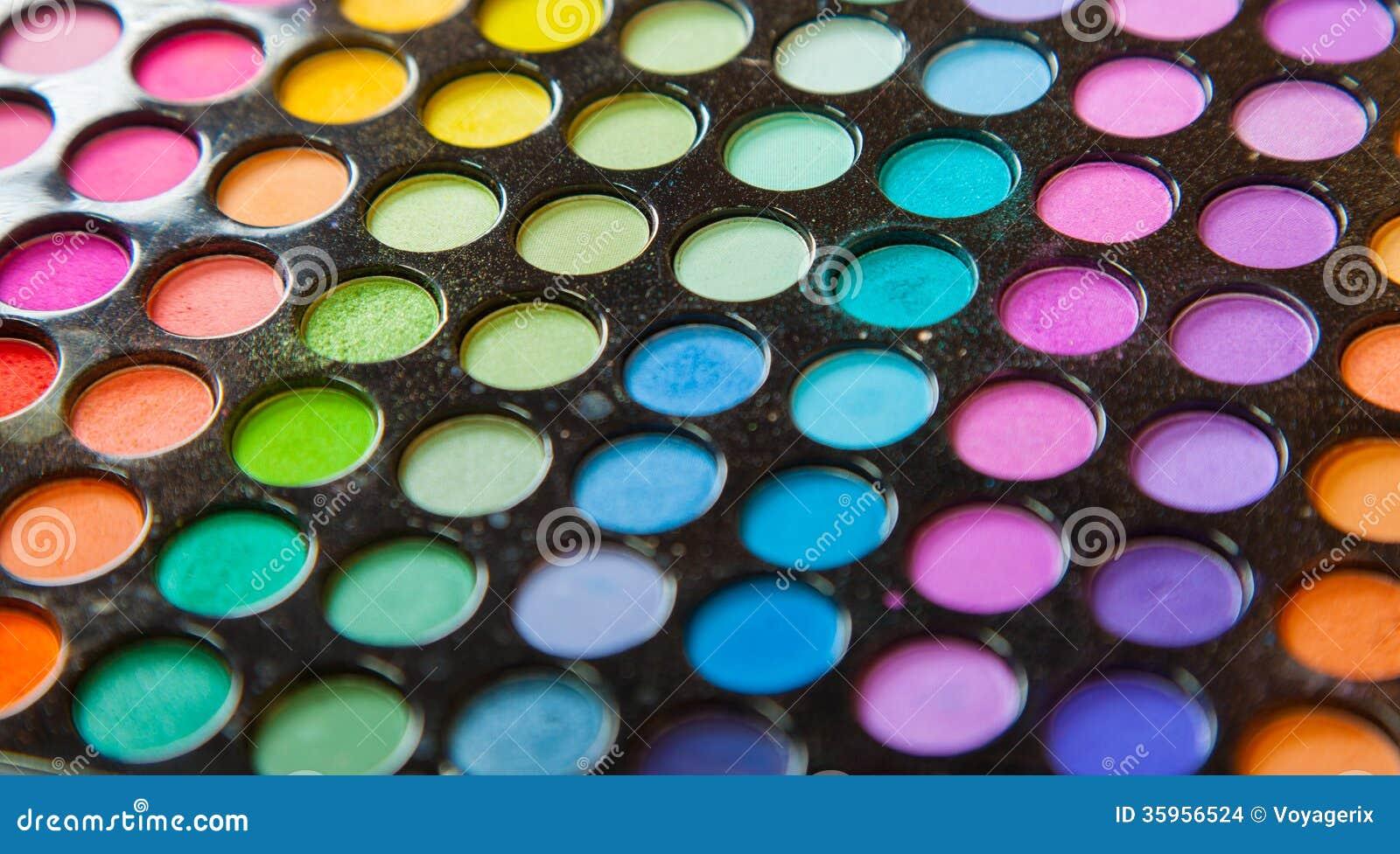 Sombras de ojos coloridas profesionales de la paleta. Fondo determinado del maquillaje.