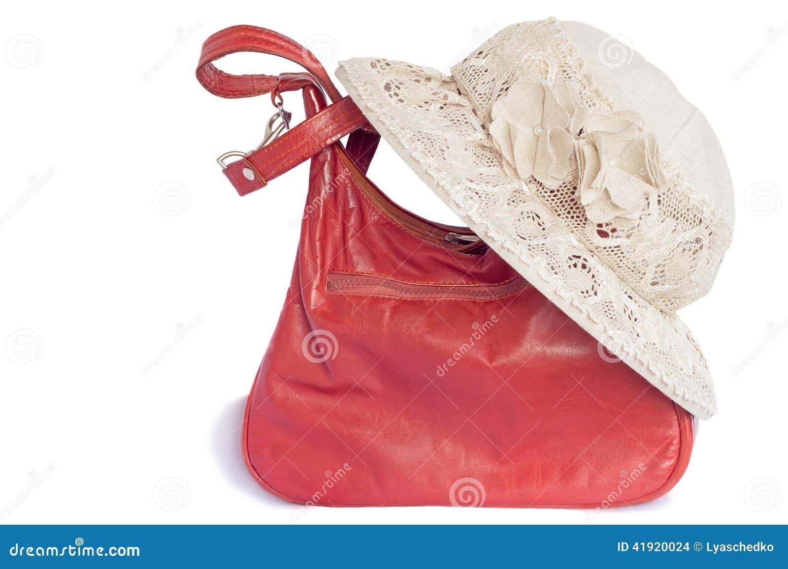 Sombrero femenino del verano para la protección contra el sol y un bolso en a