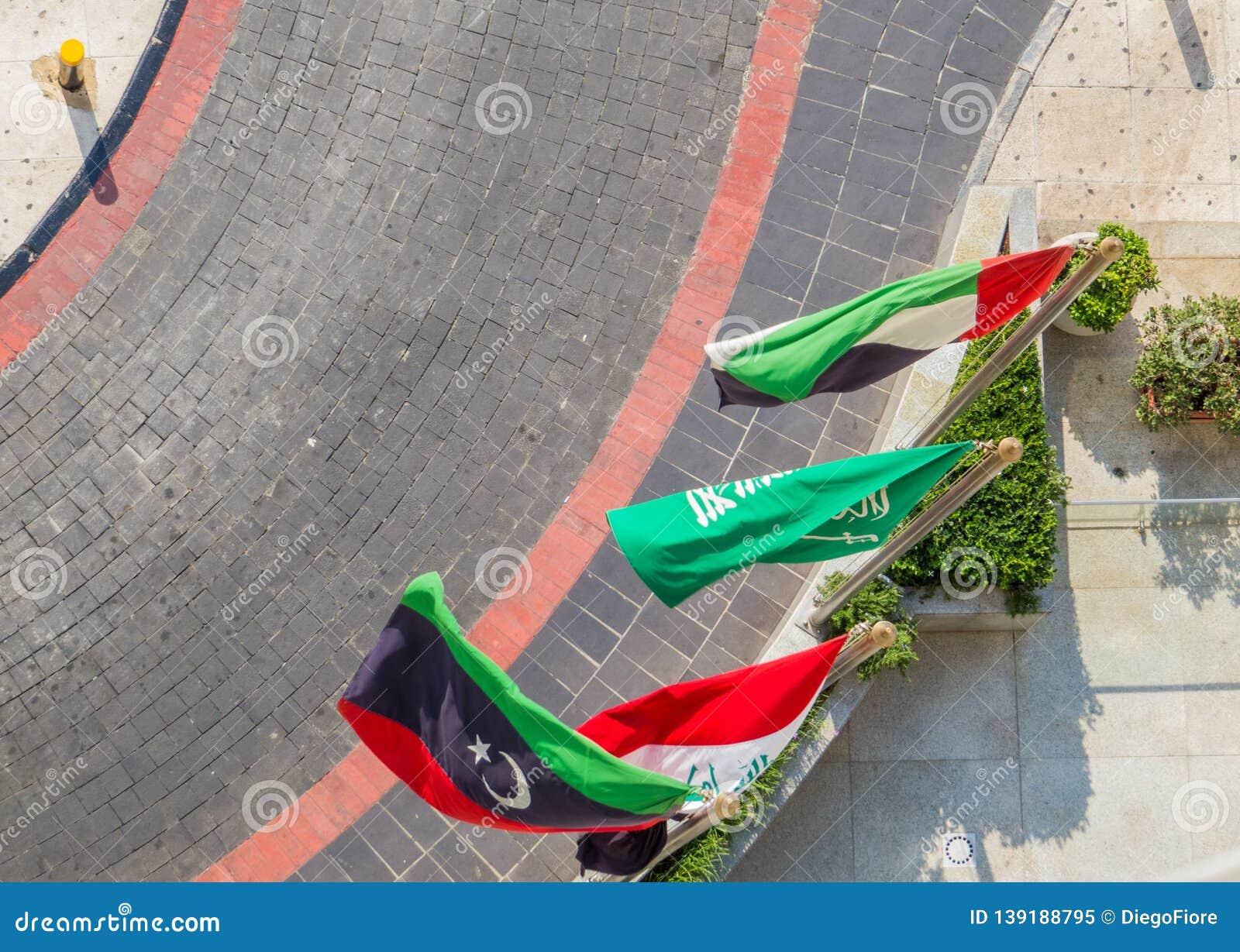 Some Arabic flags from left to right Libya, Iraq, Saudi Arabia and Jordan