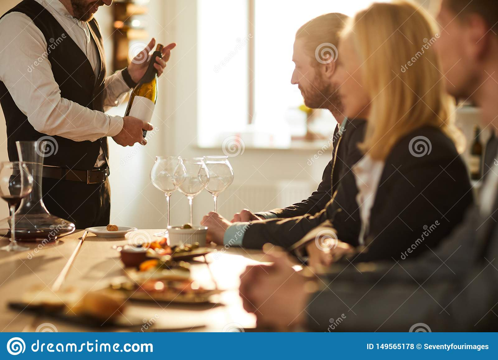 Sommelier Presenting Wine