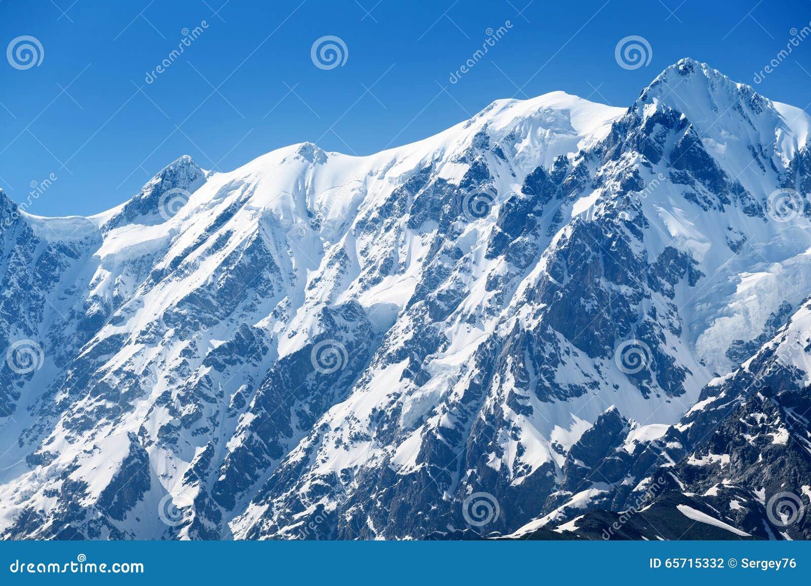 Sommet de montagne sous la neige photo stock image 65715332 - Photos de neige gratuites ...