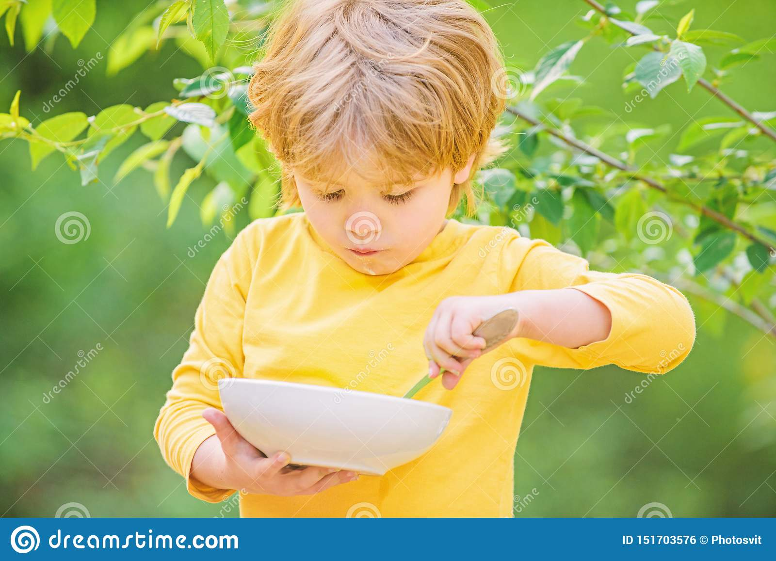 Son And Eating Milk Porridge Cereal For Breakfast Good Morning Small Boy Eating Outdoor Child Development Little Stock Photo Image Of Exploring Health 151703576