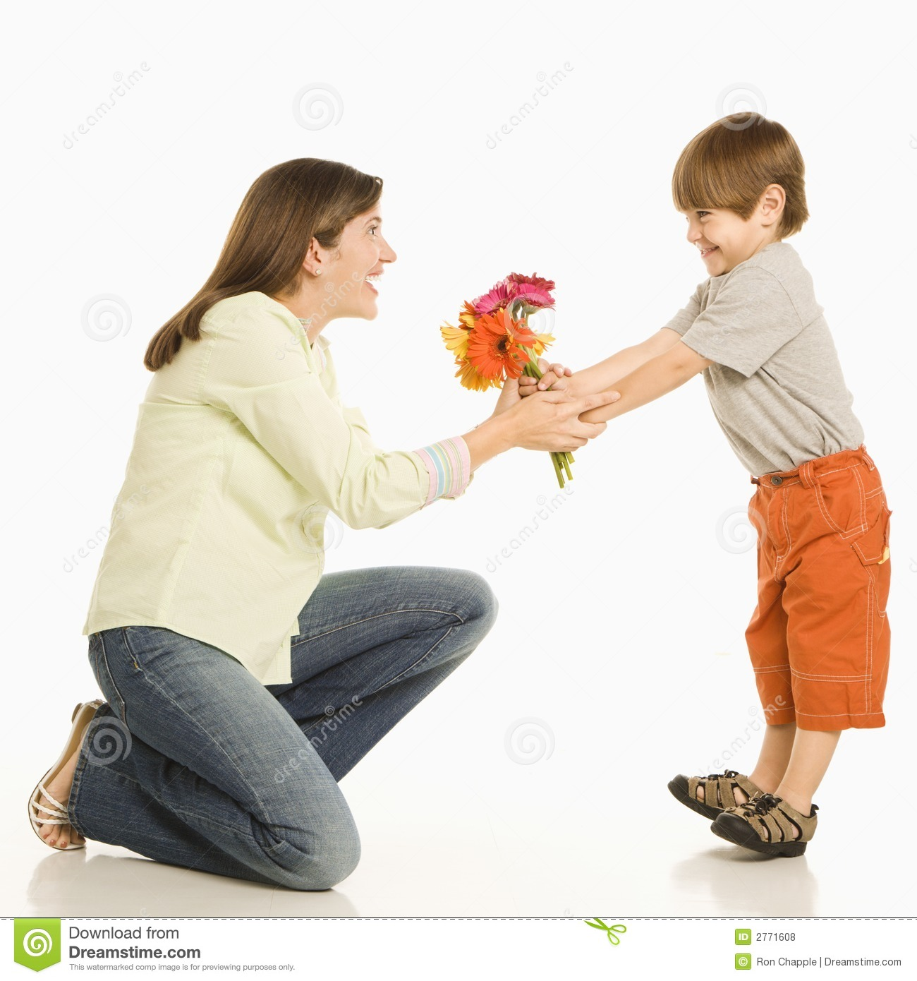 Son giving mother flowers.
