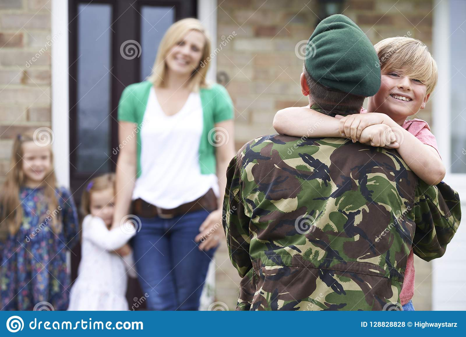 Son Greeting Military Father On Leave At Home