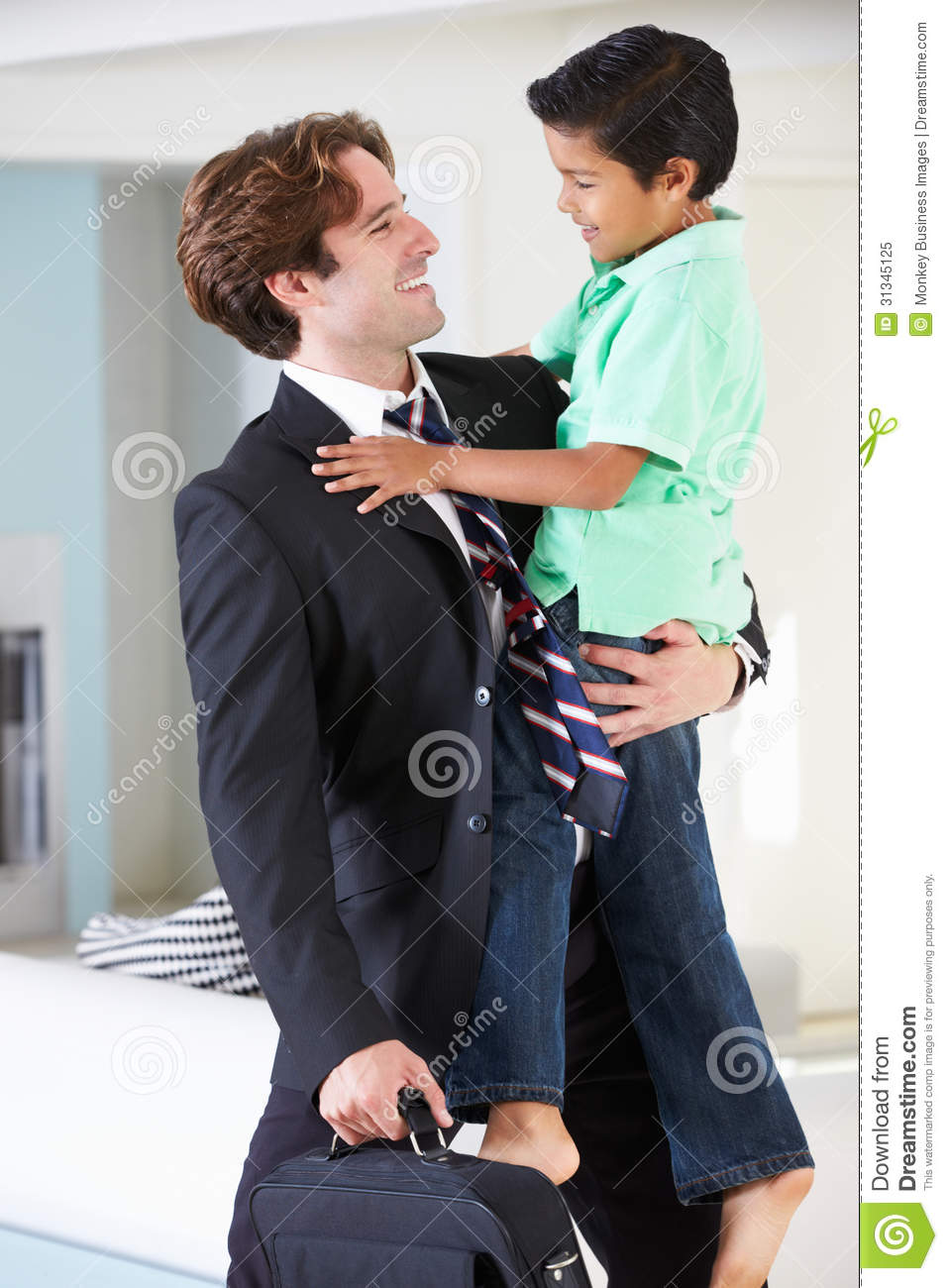 Son Greets Father On Return From Work