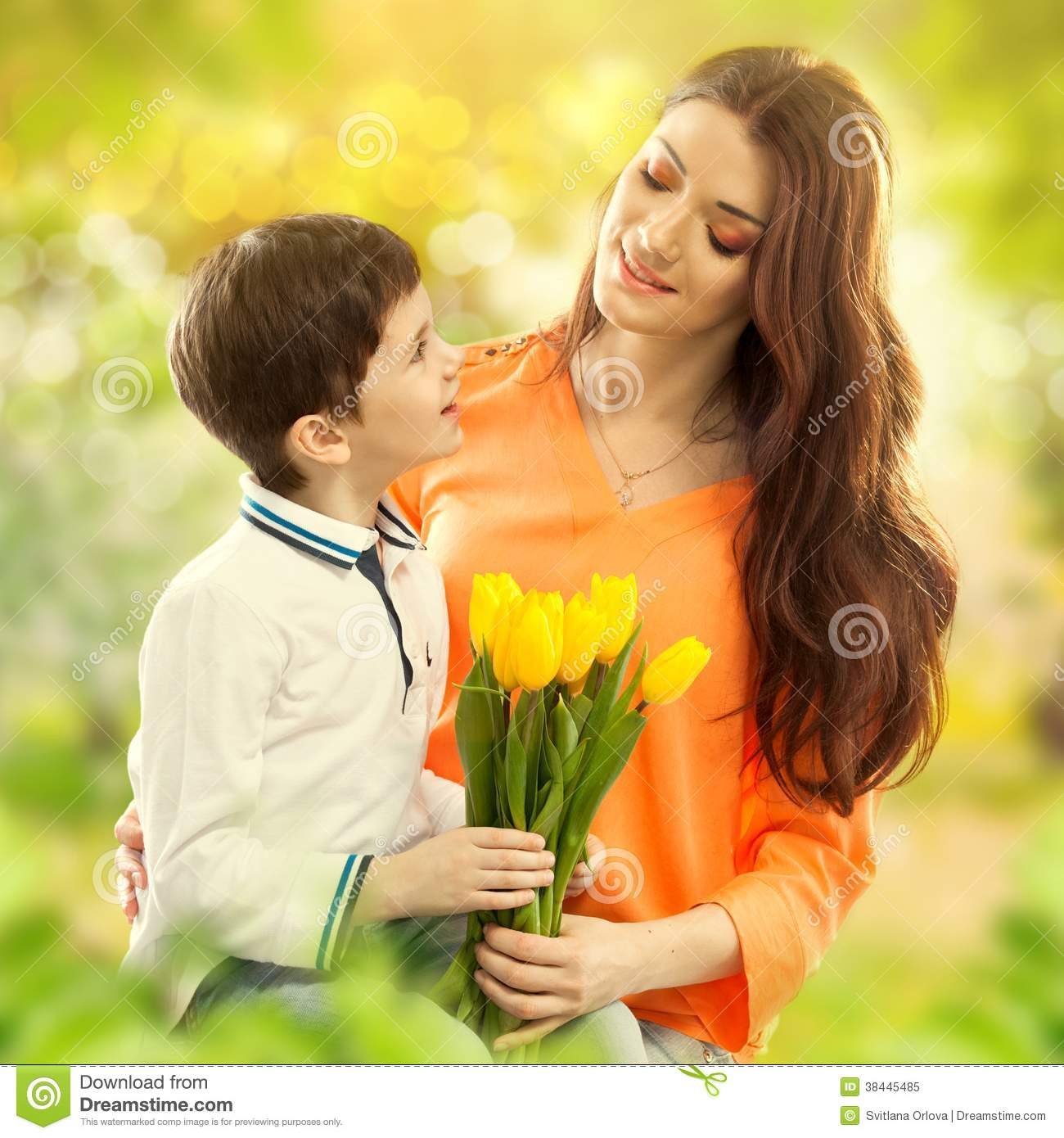 Son Hugging His Mother And Gives Her Flowers Royalty Free ...