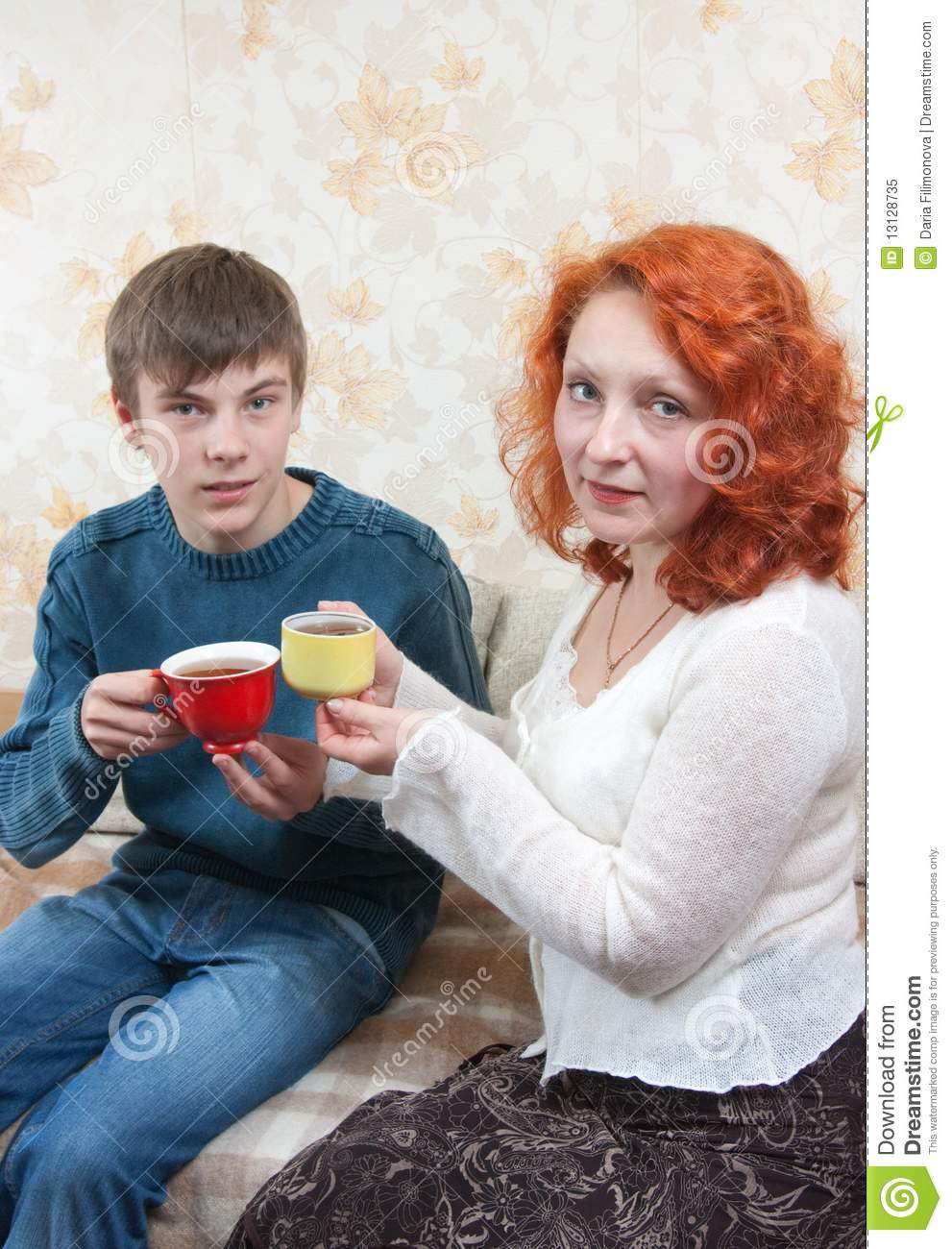Mother and son having coffee