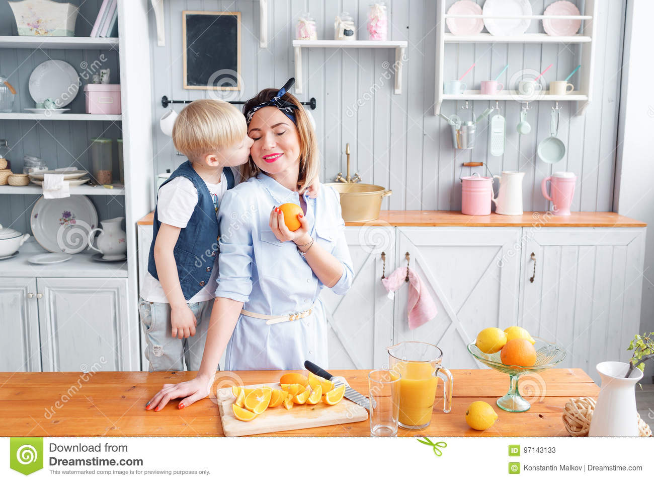 Son And Young Mother In The Kitchen Eating Breakfast. Stock Image ...