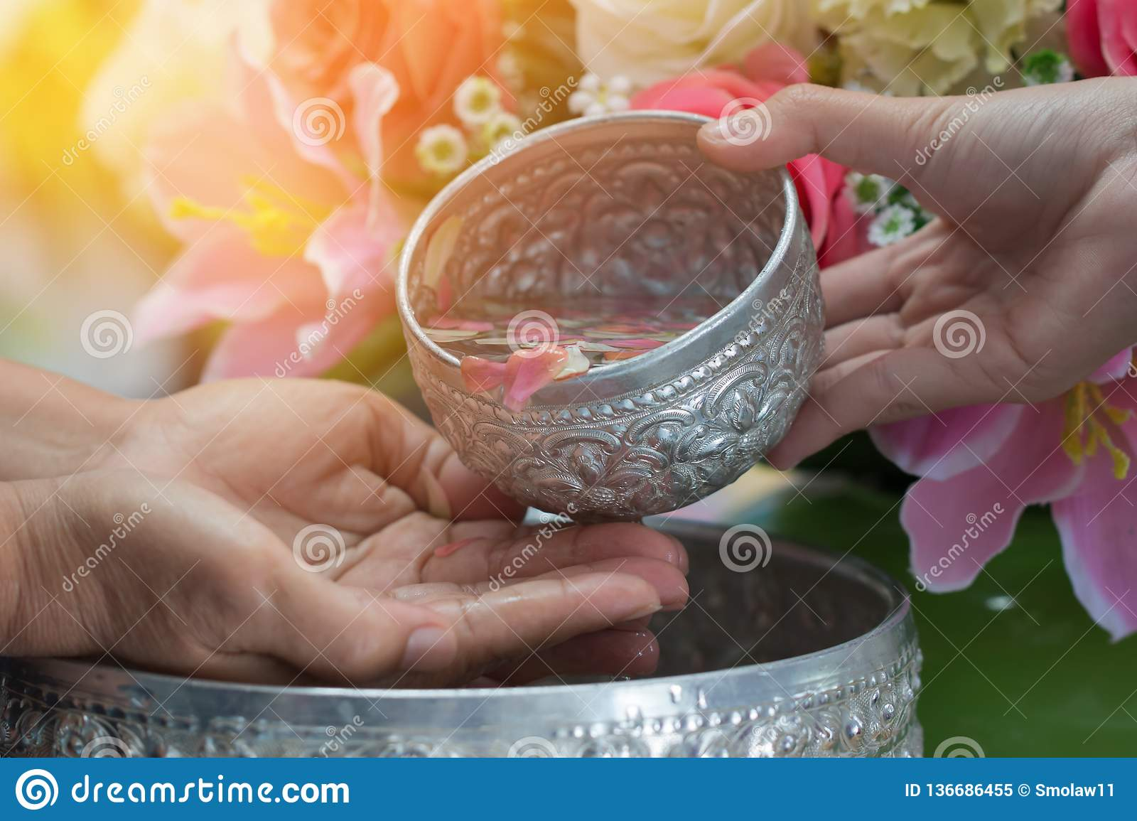Songkran Thai festival concept : Thai people celebrate Songkran in new year water festival by giving garlands to elder seniors and