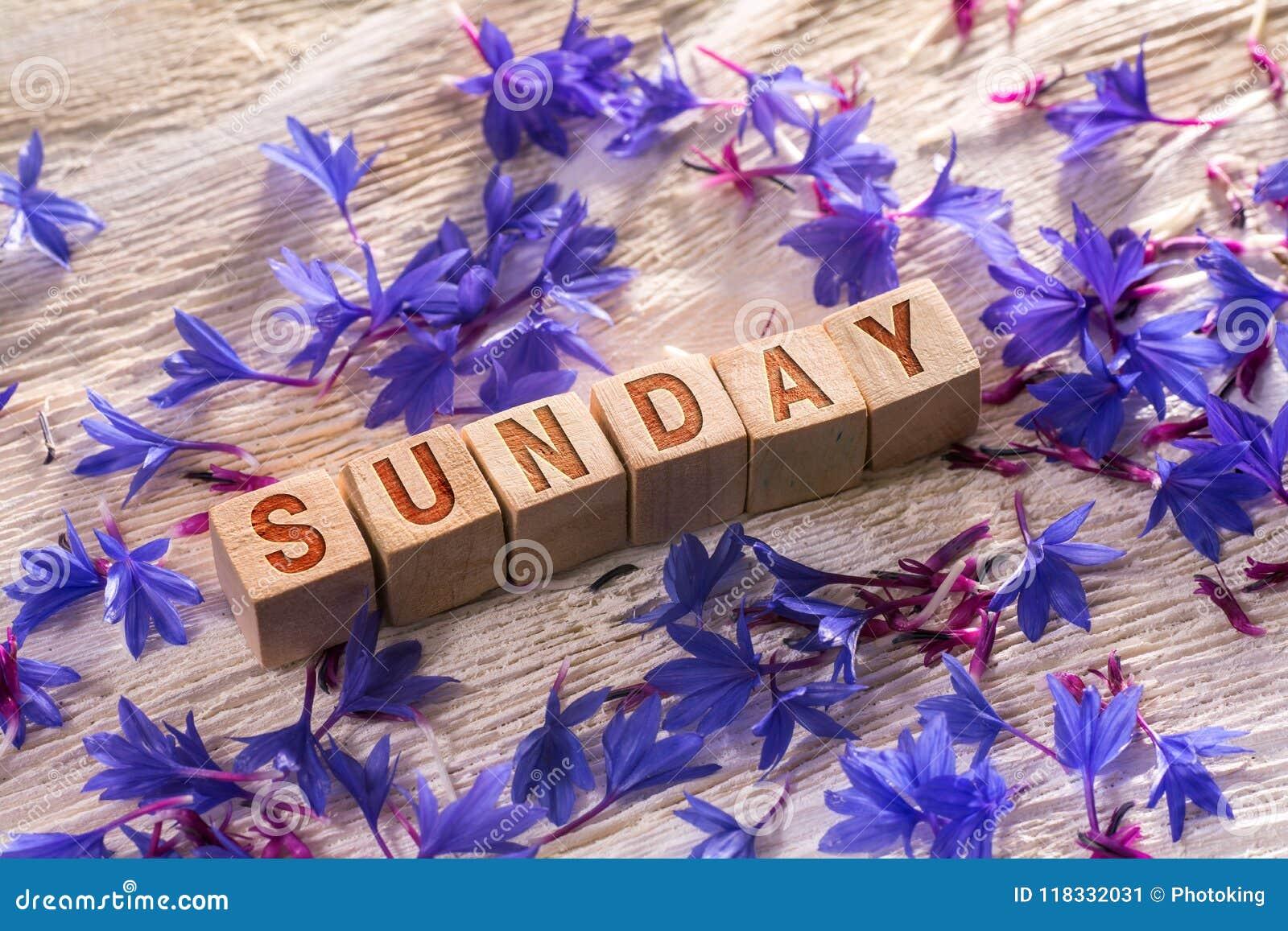 Sonntag auf den hölzernen Würfeln