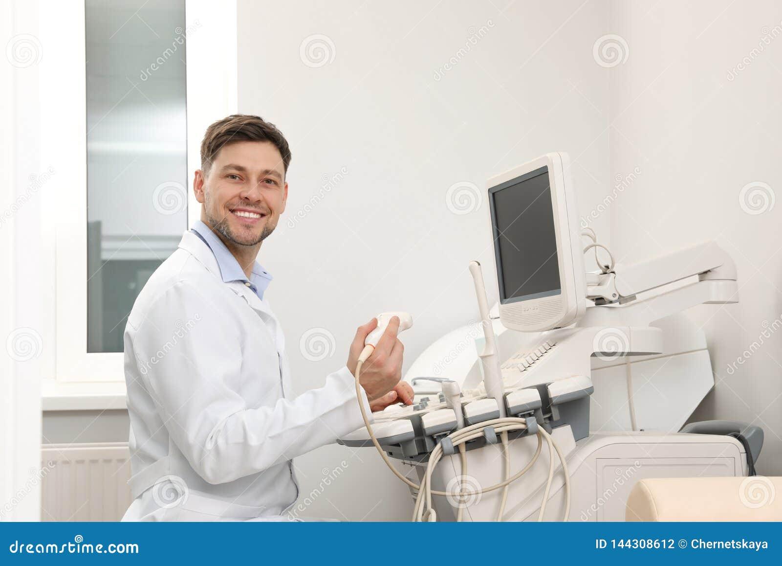 Sonographer operating modern ultrasound machine