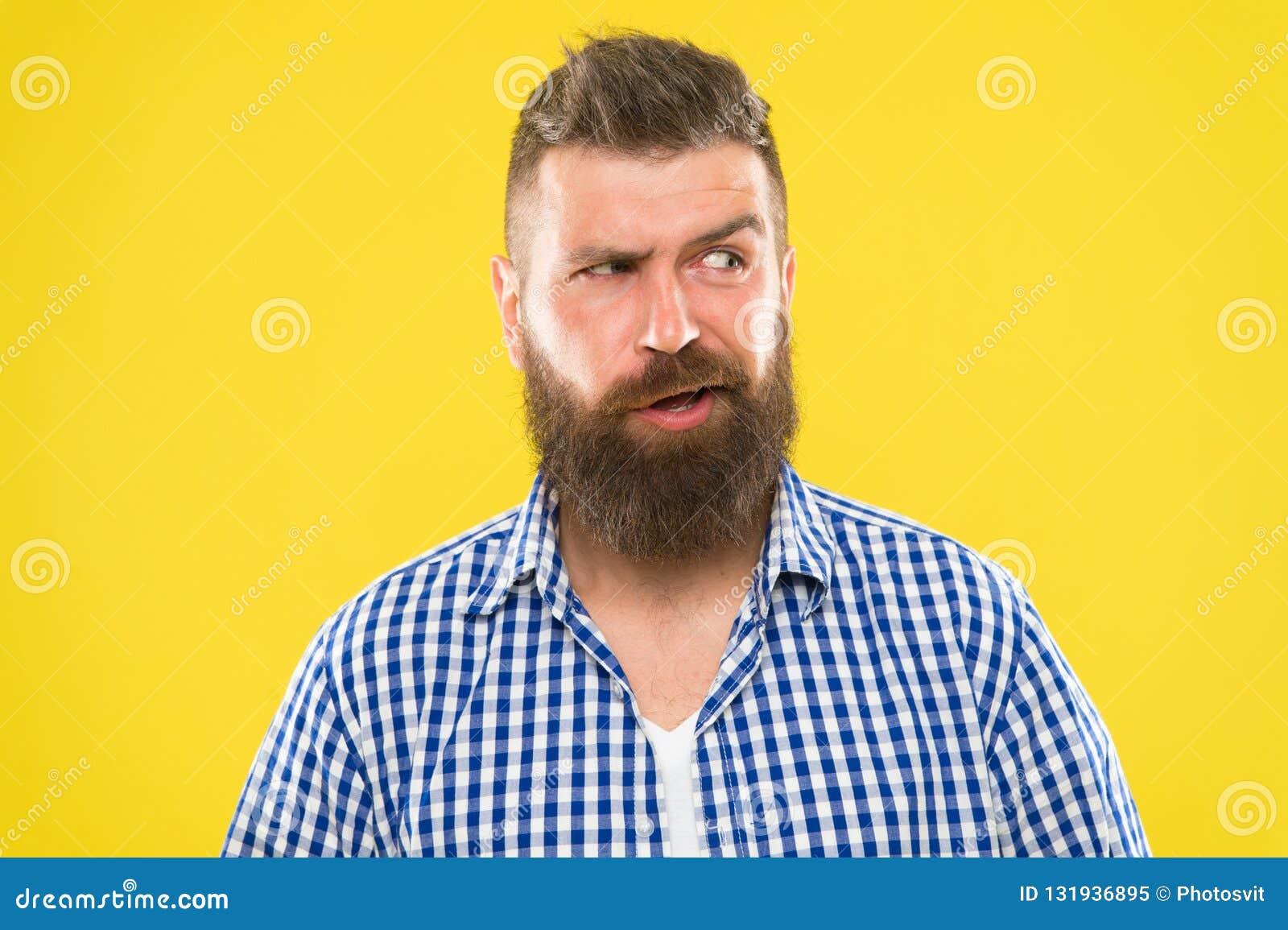 Sons complicados Cara séria do homem que aumenta a sobrancelha não segura Tenha algumas dúvidas Cara farpada do moderno não certo