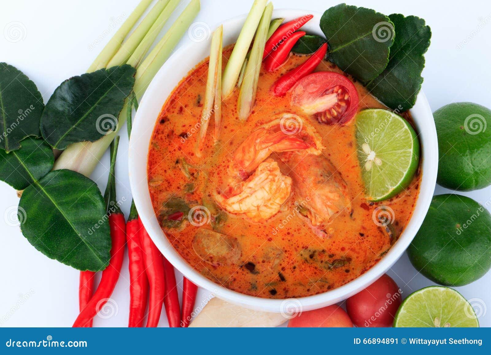 Sopa tailandesa do camarão com nardo (Tom Yum Goong) no fundo de pano de Brown