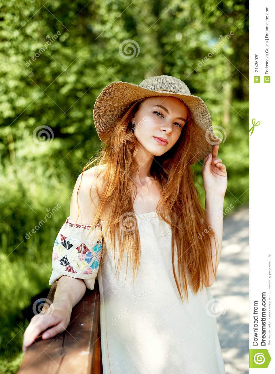 A Sophisticated Red Haired Girl In A Simple Linen Dress In